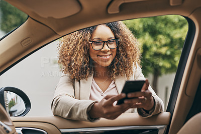 Buy stock photo Shot of an attractive businesswoman using a cellphone on her morning commute
