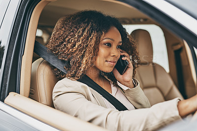Buy stock photo Shot of an attractive businesswoman on a call during her morning commute