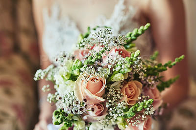 Buy stock photo Shot of an unrecognizable woman holding a bouquet of flowers at a wedding