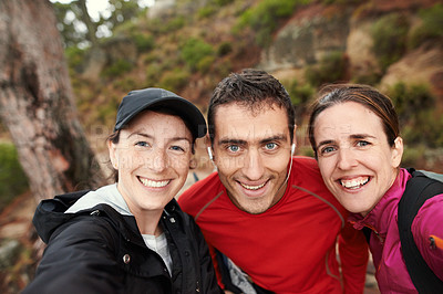 Buy stock photo Shot of a group of friends out for a trail run