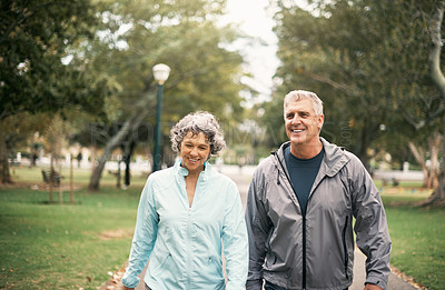 Buy stock photo Shot of a senior couple out for a walk in the park