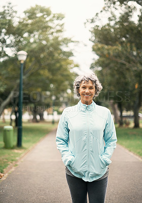 Buy stock photo Portrait of a senior woman out for a run in the park