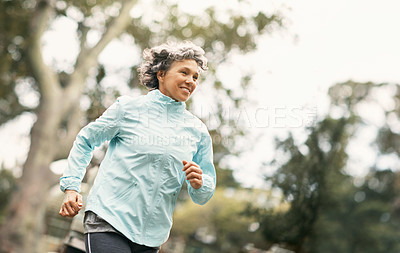Buy stock photo Shot of a senior woman out for a run in the park