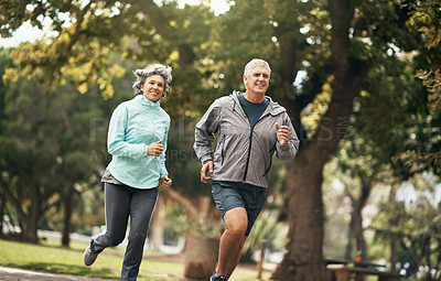 Buy stock photo Shot of a senior couple out for a run in the park