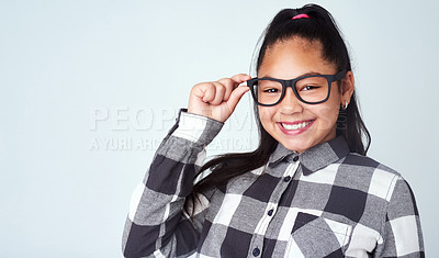 Buy stock photo Studio portrait of a cute and confident young girl posing against a gray background