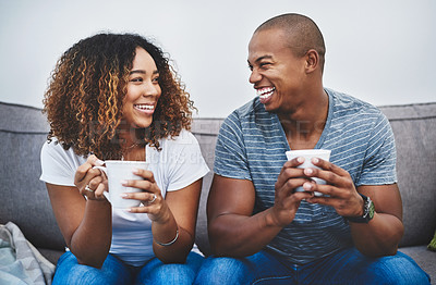 Buy stock photo Shot of a young couple relaxing together at home