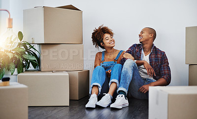 Buy stock photo Shot of an attractive young couple moving house