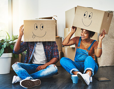 Buy stock photo Shot of a young couple moving house