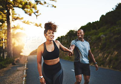 Buy stock photo Cropped shot of a happy young couple out for a run together