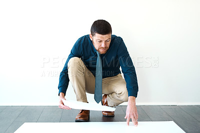 Buy stock photo Full length shot of a handsome mature male architect looking over some paperwork