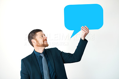 Buy stock photo Cropped shot of a handsome mature businessman holding up a speech bubble