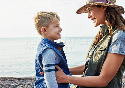 Buy stock photo Shot of a young woman and her son enjoying a day at the lake