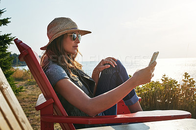 Buy stock photo Shot of an attractive young woman enjoying her day at the lake