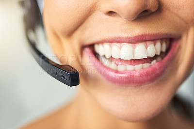 Buy stock photo Closeup shot of an unrecognizable female customer support agent smiling in the office