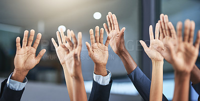 Buy stock photo Cropped shot of a group of businesspeople raising their hands