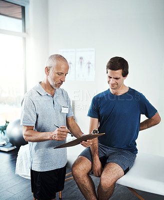 Buy stock photo Shot of a physiotherapist having a consultation with a patient