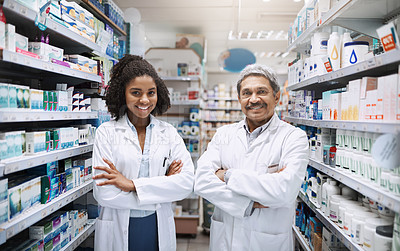 Buy stock photo Cropped portrait of two pharmacists standing together with their arms crossed in a pharmacy