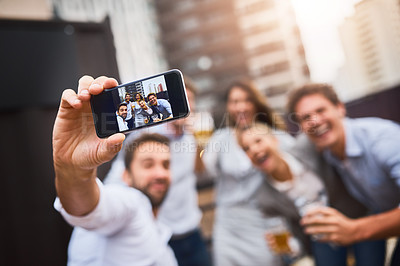 Buy stock photo Cropped shot of businesspeople having drinks on their office balcony