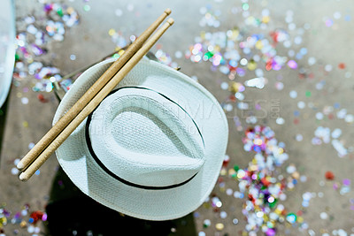 Buy stock photo High angle shot of a hat and drumsticks on the ground