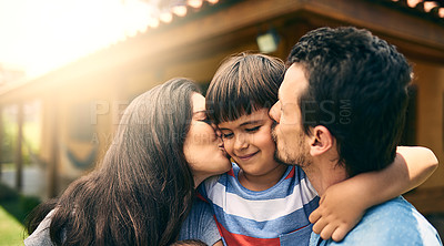 Buy stock photo Cropped shot of a young mother and father kissing their son outside