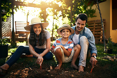 Buy stock photo Portrait of a happy family gardening together in their backyard