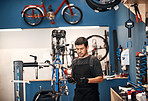 Doing what he does best, bicycle repair