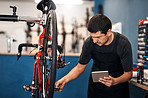 Managing his bicycle shop with modern tech