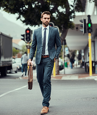 Buy stock photo Shot of a handsome young businessman out in the city