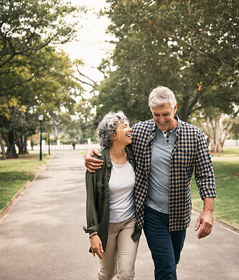 Buy stock photo Shot of a happy senior couple going for a walk in the park