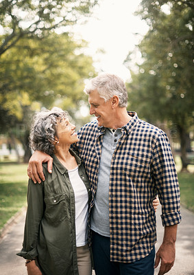 Buy stock photo Shot of a senior couple spending the day in the park