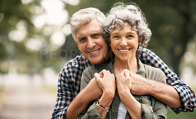 Buy stock photo Portrait of a happy senior couple embracing in the park