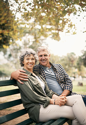 Buy stock photo Portrait of a happy senior couple relaxing on a park bench
