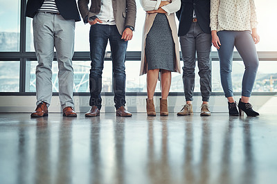 Buy stock photo Shot of a group of unrecognizable businesspeople standing in line in an office