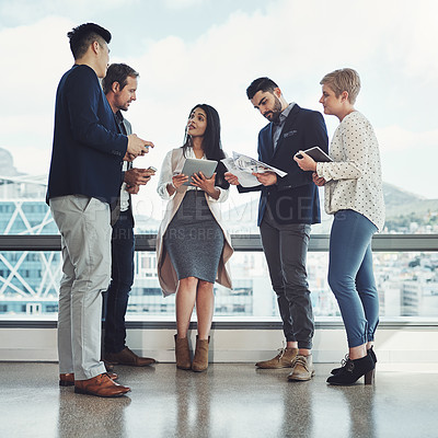Buy stock photo Shot of a diverse group of businesspeople having a discussion in an office