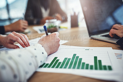 Buy stock photo Closeup shot of unrecognizable businesspeople analyzing graphs in an office