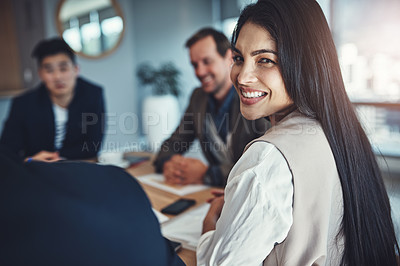 Buy stock photo Portrait of a young businessman sitting in a meeting in an office