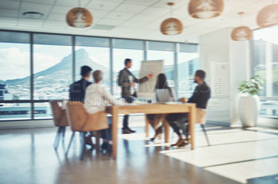 Buy stock photo Blurred shot of a group of businesspeople having a meeting in an office