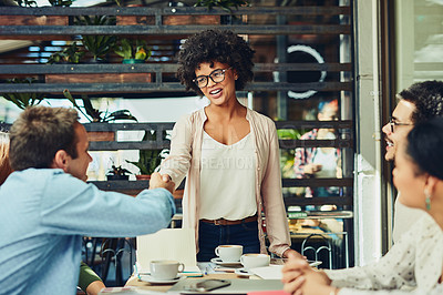 Buy stock photo Cropped shot of designers shaking hands at a coffee shop