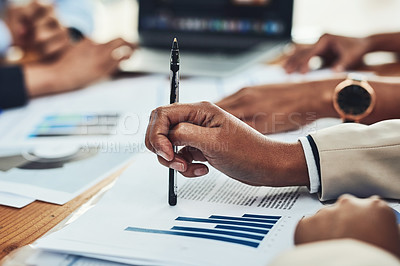 Buy stock photo Closeup shot of an unrecognizable businesspeople writing notes during a meeting in an office