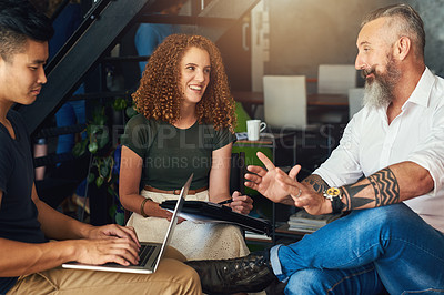Buy stock photo Cropped shot of three creative businesspeople meeting in their office
