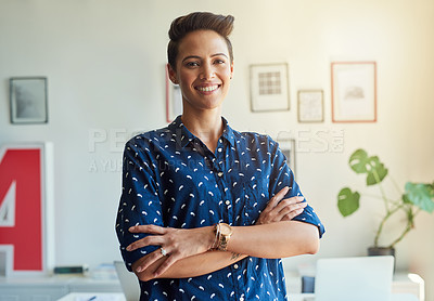 Buy stock photo Cropped portrait of an attractive young female designer standing with her arms folded in the office