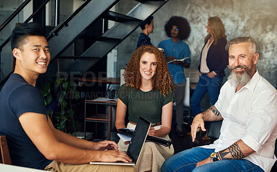 Buy stock photo Cropped portrait of three creative businesspeople meeting in their office