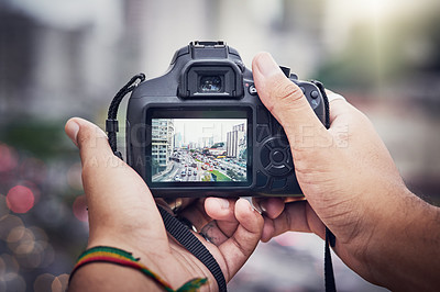 Buy stock photo Shot of an unrecognizable man taking pictures with a camera in the city