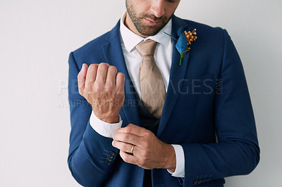 Buy stock photo Cropped studio shot of a stylish young groom against a gray background