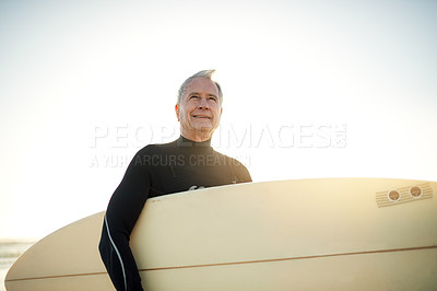 Buy stock photo Cropped shot of a senior man on his way to go surfing