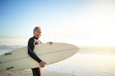 Buy stock photo Cropped shot of a senior man going surfing