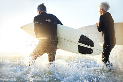 Buy stock photo Shot of a senior married couple going surfing