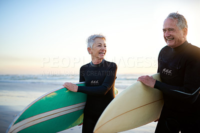 Buy stock photo Cropped shot of a senior married couple coming from surfing