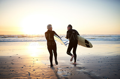 Buy stock photo Rearview shot of a senior married couple going surfing