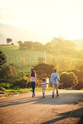 Buy stock photo Rearview shot of a family walking in the countryside